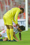 Villarreal's Dos Santos aid Sevilla's Tremoulinas during the match between Sevilla FC and Villarreal day 9 spanish  BBVA League 2014-2015 day 5, played at Sanchez Pizjuan stadium in Seville, Spain. (PHOTO: CARLOS BOUZA / BOUZA PRESS / ALTER PHOTOS)
