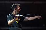 © Joel Goodman - 07973 332324 . 01/07/2017 . Manchester , UK . Conductor Tim Crooks , wearing a t-shirt with a worker bee , the emblem of Manchester . Hacienda Classical play at the Castlefield Bowl as part of Sounds of the City , during the Manchester International Festival . A collaboration between DJs Mike Pickering and Graeme Park and the Manchester Camerata orchestra , Hacienda Classical reworks music by bands including the Happy Mondays and New Order and features Manchester musicians including Rowetta and Peter Hook . Photo credit : Joel Goodman