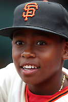 SAN FRANCISCO, CA - JULY 1:  Darren Baker, son of Manager Dusty Baker #12 of the Cincinnati Reds wears a San Francisco Giants jersey and hat during on field ceremonies honoring the Giants 2002 National League Championship team that Baker managed. Darren Baker later threw out the first pitch before the game against the San Francisco Giants at AT&T Park on Sunday, July 1, 2012 in San Francisco, California. Photo by Brad Mangin