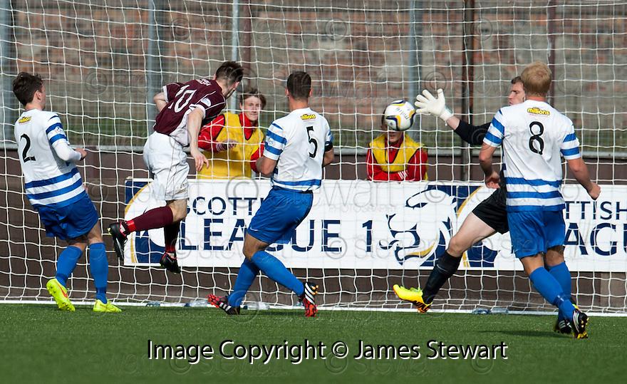 Stenny's Sean Dickson scores their second goal.