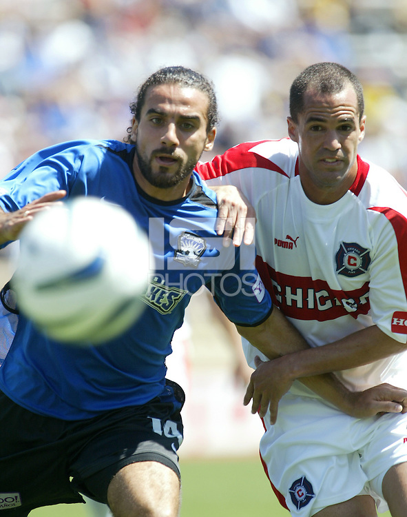 San Jose Earthquakes forward Dwayne DeRosario and Chicago Fire defender Evan Whitfield battle for a loose ball during their MLS match on April 10, 2004 at Spartan Stadium in San Jose, California.  The game ended in a scoreless tie.