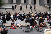 NEW YORK, NEW YORK - JUNE 2: Protestors maintain silence for eight minutes during a protest against the death of George Floyd on June 2, 2020 in New York. This period of time represents how long a police officer knelt on George Floyd's neck until Mr. Floyd died. The protests spread across the country in at least 30 cities across the United States, over the death of unarmed black man George Floyd at the hands of a police officer, this is the latest death in a series of police deaths of black Americans. (Photo by Stephen Ferry /VIEWpress via Getty Images)