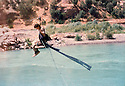 Iraq 1982 .Hatge yachar on her way to the mountains, crossing the Zab river  .Irak 1982 .Hatge Yachar en route pour les montagnes traverse la riviere Zab