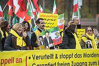 """Mehrere hundert Exil-Iraner demonstrierten am Samstag den 23. November 2019 in Berlin gegen die Regierung in Teheran. Sie solidarisierten sich mit den Aufstaendischen, die seit mehreren Wochen gegen das Regime protestieren. Mehr als 250 Menschen sollen bei den Protesten mittlerweile von den sog. """"Revolutionsgarden"""" erschossen worden sein.<br /> Aufgerufen zu der Demonstration vor dem Brandenburger Tor hatte die Gruppe """"Nationaler Widerstandsrat Iran"""" - NWRI.<br /> Im Bild: Einige Demonstranten trugen ein Portrait des NWRI-Mitbegruenders Massoud Rajavi mit der englischen Aufschrift """"Massud ist unser Anfuehrer"""".<br /> 23.11.2019, Berlin<br /> Copyright: Christian-Ditsch.de<br /> [Inhaltsveraendernde Manipulation des Fotos nur nach ausdruecklicher Genehmigung des Fotografen. Vereinbarungen ueber Abtretung von Persoenlichkeitsrechten/Model Release der abgebildeten Person/Personen liegen nicht vor. NO MODEL RELEASE! Nur fuer Redaktionelle Zwecke. Don't publish without copyright Christian-Ditsch.de, Veroeffentlichung nur mit Fotografennennung, sowie gegen Honorar, MwSt. und Beleg. Konto: I N G - D i B a, IBAN DE58500105175400192269, BIC INGDDEFFXXX, Kontakt: post@christian-ditsch.de<br /> Bei der Bearbeitung der Dateiinformationen darf die Urheberkennzeichnung in den EXIF- und  IPTC-Daten nicht entfernt werden, diese sind in digitalen Medien nach §95c UrhG rechtlich geschuetzt. Der Urhebervermerk wird gemaess §13 UrhG verlangt.]"""