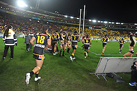 The Warriors run onto the pitch during the NRL match between the NZ Warriors and Canterbury Bulldogs at Westpac Stadium, Wellington, New Zealand on Saturday, 11 May 2013. Photo: Dave Lintott / lintottphoto.co.nz
