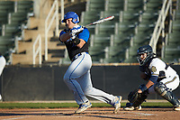 Brayden Olson (18) of the Barton Bulldogs follows through on his swing against the Queens Royals at Intimidators Stadium on March 19, 2019 in Kannapolis, North Carolina. The Royals defeated the Bulldogs 6-5. (Brian Westerholt/Four Seam Images)