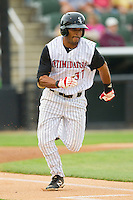 Micah Johnson (37) of the Kannapolis Intimidators hustles down the first base line against the Hagerstown Suns at CMC-Northeast Stadium on May 16, 2013 in Kannapolis, North Carolina.  The Suns defeated the Intimidators 10-7.   (Brian Westerholt/Four Seam Images)