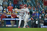 Justin Mitchell (14) of the Oklahoma Sooners slaps hands with third base coach Clay Van Hook (19) as he rounds the bases after hitting a home run against the LSU Tigers in game seven of the 2020 Shriners Hospitals for Children College Classic at Minute Maid Park on March 1, 2020 in Houston, Texas. The Sooners defeated the Tigers 1-0. (Brian Westerholt/Four Seam Images)
