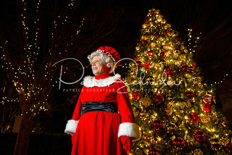 Charlotte Christmas Events - Photography of the Phillips Place Winter Wonderland Christmas event in Charlotte, North Carolina.<br /> <br /> Mrs. Claus near a Christmas tree.<br /> <br /> Charlotte Photographer - PatrickSchneiderPhoto.com