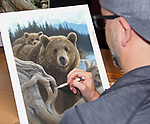 """NOTE FOR ONLINE:  MAXIMUM OF 10 IMAGES TO RUN ALONGSIDE THIS STORY - UNLESS OTHERWISE AGREED WITH A REVISED FEE IN PLACE.<br /> <br /> Pictured:  Collin Bogle putting the finishing touches to one of his realistic paintings.<br /> <br /> These intricately detailed pictures of wild animals look like photographs - but are in fact paintings.  American artist Collin Bogle's extraordinary work portrays close up encounters with animals such as lions, snow leopards, wolves, eagles and bears.<br /> <br /> He uses photos of the animals as a reference and spends between two weeks and two months painstakingly creating each piece.  Mr Bogle, who works out of his home in Seattle, Washington, in the United States, said: """"My dad is an artist and was also a high school art teacher - so I started learning to paint as soon as I could hold a brush.  SEE OUR COPY FOR DETAILS.<br /> <br /> Please byline: Collin Bogle/Solent News<br /> <br /> © Collin Bogle/Solent News & Photo Agency<br /> UK +44 (0) 2380 458800"""