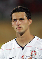 The United States' Dilly Duka (10) stands for the American National Anthem before the game against Cameroon before the FIFA Under 20 World Cup Group C Match between the United States and Cameroon at the Mubarak Stadium on September 29, 2009 in Suez, Egypt.