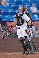 Catcher John Curtis #24 of the Winston-Salem Dash looks for a foul pop up at Wake Forest Baseball Stadium August 6, 2009 in Winston-Salem, North Carolina. (Photo by Brian Westerholt / Four Seam Images)