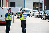 Monday 19 June 2017<br /> Pictured: Police at the entrance to the hire firm <br /> Re: The van which was driven by Darren Osborne into worshippers near a north London mosque was hired by a firm in south Wales. One man has died and 10 people have been injured after a van mounted a pavement near Finsbury Park Mosque.Forensics officers are examining a white van which has Pontyclun Van Hire on it.