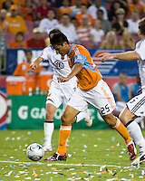 Houston Dynamo forward Brian Ching (25) strikes the ball for a goal.  Houston Dynamo defeated D.C. United 4-3 at Robertson Stadium in Houston, TX on August 1, 2009.