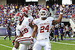 Oklahoma Sooners running back Damien Williams (26) and Oklahoma Sooners running back Brennan Clay (24) in action during the game between the Oklahoma Sooners and the TCU Horned Frogs  at the Amon G. Carter Stadium in Fort Worth, Texas. OU defeats TCU 24 to 17.