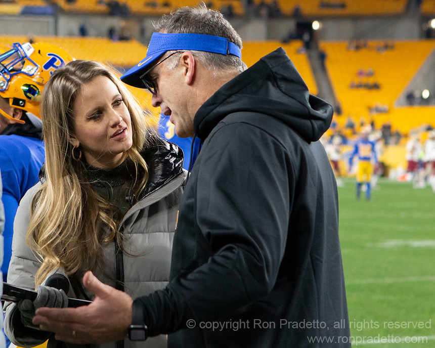 Pitt head football coach Pat Narduzzi gets interviewed at halftime by ACC sideline reporter Kelsey Riggs. The Boston College Eagles defeated the Pitt Panthers 26-19 in the football game played at Heinz Field, Pittsburgh Pennsylvania on November 30, 2019.