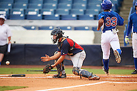 Zack Smith (4) of Eastern Wayne High School in Goldsboro, North Carolina waits for a throw as Jaren Shelby (33) scores a run while playing for the Cleveland Indians scout team during the East Coast Pro Showcase on July 29, 2015 at George M. Steinbrenner Field in Tampa, Florida.  (Mike Janes/Four Seam Images)