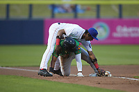 Marcus Smith (15) of the Down East Wood Ducks slides into third base under the tag of DJ Gladney (8) of the Kannapolis Cannon Ballers at Atrium Health Ballpark on May 5, 2021 in Kannapolis, North Carolina. (Brian Westerholt/Four Seam Images)
