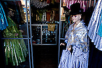 """Aymara Women fashion shop, traditional """"Cholita"""" outfits.Just 25 years ago it was a small group of houses around La Paz  airport, at an altitude of 12,000 feet. Now El Alto city  has  nearly one million people, surpassing even the capital of Bolivia, and it is the city of Latin America that grew faster .<br /> It is also a paradigmatic city of the troubles  and traumas of the country. There got refugee thousands of miners that lost  their jobs in 90 ´s after the privatization and closure of many mines. The peasants expelled by the lack of land or low prices for their production. Also many who did not want to live in regions where coca  growers and the Army  faced with violence.<br /> In short, anyone who did not have anything at all and was looking for a place to survive ended up in El Alto.<br /> Today is an amazing city. Not only for its size. Also by showing how its inhabitants,the poorest of the poor in one of the poorest countries in Latin America, managed to get into society, to get some economic development, to replace their firs  cardboard houses with  new ones made with bricks ,  to trace its streets,  to raise their clubs, churches and schools for their children.<br /> Better or worse, some have managed to become a sort of middle class, a section of the society that sociologists call  emerging sectors. Many, maybe  most of them, remain for statistics as  poor. But clearly  all of them have the feeling they got  for their children a better life than the one they had to face themselves ."""