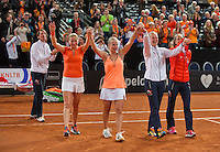 Februari 08, 2015, Apeldoorn, Omnisport, Fed Cup, Netherlands-Slovakia, doubles, Dutch team l.t.r.: captain Paul Haarhuis, Michealla Krajicek and Richel Hogenkamp, Kiki Bertens and Arantxa Rus  celebrate the 4-1 win over Slovakia<br /> Photo: Tennisimages/Henk Koster
