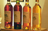 Four bottles of Chateau Caillou of varying age (1921, 1937, 1959, 1999) showing the change in colour that occurs when sauternes wine ages.  Chateau Caillou, Grand Cru Classe, Barsac, Sauternes, Bordeaux, Aquitaine, Gironde, France, Europe