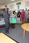 Adams is applauded for her accomplishment by Jones, Huewitt and the students at Lanier Middle School.
