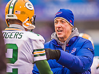 14 December 2014: Pro NFL Football Hall of Fame Member and former Buffalo Bills quarterback Jim Kelly chats with Green Bay Packers quarterback Aaron Rodgers prior to a game at Ralph Wilson Stadium in Orchard Park, NY. The Bills defeated the Packers 21-13, snapping the Packers' 5-game winning streak and keeping the Bills' 2014 playoff hopes alive. Mandatory Credit: Ed Wolfstein Photo *** RAW (NEF) Image File Available ***