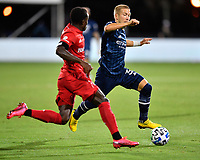 LAKE BUENA VISTA, FL - JULY 26: Anton Tinnerholm of New York City FC is pursued by Richie Laryea of Toronto FC as he cuts inside during a game between New York City FC and Toronto FC at ESPN Wide World of Sports on July 26, 2020 in Lake Buena Vista, Florida.
