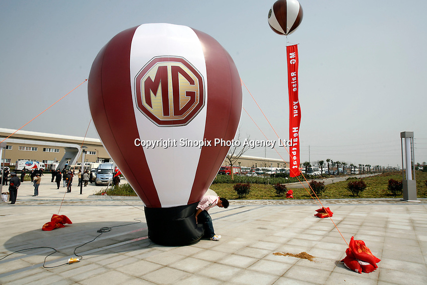 A chinese man set up a balloon displaying a MG logo at the launching ceremony of the first Chinese built MG vehicles in Nanjing, China. The Chinese company is now in a position to take on Rover's assets and plan its future. It intended to relocate the engine plant and some car production plant to China but to retain some car production plant in the UK..27 Mar 2007