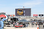 The world's biggest TV, Big Hoss, shows some action during the NASCAR Nationwide Series qualifying at Texas Motor Speedway in Fort Worth,Texas.
