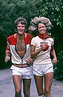 Farrah Fawcett and husband Lee Majors jogging near their home in Los Angeles, California, 1977. Photo by John G. Zimmerman.