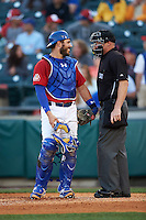 Buffalo Bisons catcher Tony Sanchez (26) talks with umpire James Rackley during a game against the Louisville Bats on June 22, 2016 at Coca-Cola Field in Buffalo, New York.  Buffalo defeated Louisville 8-1.  (Mike Janes/Four Seam Images)