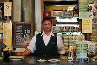 Il Bar Fratelli Nurzia ha riaperto a dicembre 2009..Il Barman Ulisse Di Vincenzo..Dopo il terremoto  del 2009 alcuni negozi e attività commerciali riaprono a L'Aquila..After the earthquake of 2009, some shops and businesses reopen in L'Aquila.