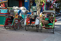 Yogyakarta, Java, Indonesia.  Becak (three-wheeled, man-powered rickshaws) Drivers Waiting for Passengers.