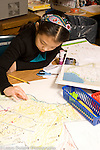 Elementary School Grade 3 girl working on map project