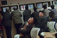 Chinese investor take a rest at the stock exchange in Beijing, China. A weaker dollar in global markets coupled with calls from the US Treasury for faster China exchange rate reforms pushed the yuan to a fresh high against the US dollar recently..01 Feb 2007
