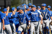 Catcher Jackson Morrow #14 of the UC Santa Barbara Gauchos celebrates with teammates after a win against the Cal State Northridge Matadors at Matador Field on May 11, 2013 in Northridge, California. UC Santa Barbara defeated Cal State Northridge, 6-2. (Larry Goren/Four Seam Images)
