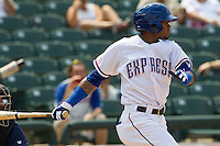 Round Rock Express outfielder Engel Beltre (7) follows through on his swing against the Colorado Springs Sky Sox in the Pacific Coast League baseball game on May 19, 2013 at the Dell Diamond in Round Rock, Texas. Colorado Springs defeated Round Rock 3-1 in 10 innings. (Andrew Woolley/Four Seam Images).