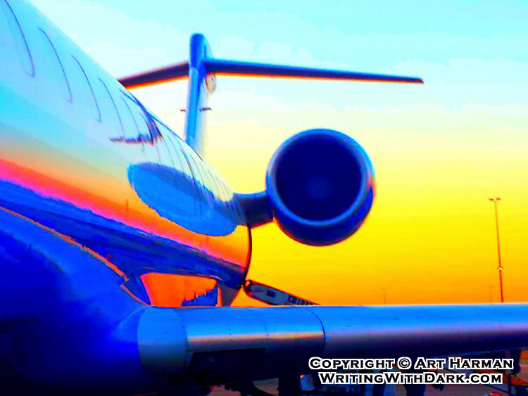 Boarding a flight at dawn, as the rising sun painted the aircraft and sky. I posterized this to create a more artful look.