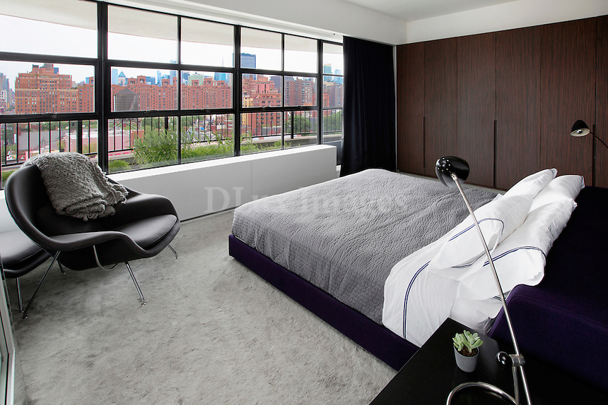 contemporary bedroom with town view