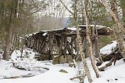 The snow covered trestle No. 16 (Black Brook Trestle) along the old East Branch & Lincoln Railroad (1893-1948) in the Pemigewasset Wilderness of Lincoln, New Hampshire. Built in the early 1900s, trestle No. 16, seen here in January 2011, is the only remaining wooden trestle still standing along the railroad.