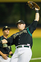 First baseman Kevin Gillespie #9 of the Charlotte 49ers catches a foul pop fly against the Wake Forest Demon Deacons at Gene Hooks Field on March 22, 2011 in Winston-Salem, North Carolina.   Photo by Brian Westerholt / Four Seam Images