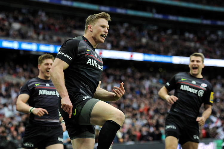 Chris Ashton of Saracens celebrates scoring a try in the corner