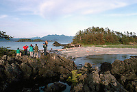 Eco Tourists exploring a Rocky Beach in Kyuquot Sound, along the Pacific West Coast of Vancouver Island, British Columbia, Canada