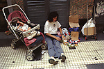 Beggar begging on the street with children, child family poverty  Buenos Aires Argentina South America 2002. 2000s
