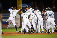 West Michigan Whitecaps first baseman Will Allen (16) is mobbed by teammates, including Leonardo Laffita (29), Brett Pirtle (5), Derek Hill (21), and Beau Burrows (34), after a game wining base hit during a game against the Burlington Bees on July 25, 2016 at Fifth Third Ballpark in Grand Rapids, Michigan.  West Michigan defeated Burlington 4-3.  (Mike Janes/Four Seam Images)