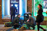 © Joel Goodman - 07973 332324 . 07/04/2017 . Manchester , UK . Paramedics attend to a man who is slumped over in front of a bin by a cash dispenser in Piccadilly Gardens . Greater Manchester Police have authorised dispersal powers and say they will ban people from the city centre for 48 hours , this evening (7th April 2017) , in order to tackle alcohol and spice abuse . Photo credit : Joel Goodman