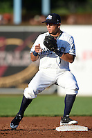 West Michigan Whitecaps second baseman Javier Betancourt (7) waits for a throw during a game against the Great Lakes Loons on June 4, 2014 at Fifth Third Ballpark in Comstock Park, Michigan.  West Michigan defeated Great Lakes 4-1.  (Mike Janes/Four Seam Images)