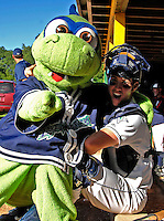"""12 July 2007: Vermont Lake Monsters catcher Sean Rooney fools around with mascot """"Champ"""" prior to a game against the Mahoning Valley Scrappers at Historic Centennial Field in Burlington, Vermont. The Scrappers defeated the Lake Monsters 11-2 in the first game of their NY Penn-League double-header...Mandatory Photo Credit: Ed Wolfstein Photo"""