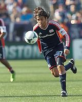 New England Revolution midfielder Juan Carlos Toja (7) on the attack.  In a Major League Soccer (MLS) match, the New England Revolution (blue) defeated LA Galaxy (white), 5-0, at Gillette Stadium on June 2, 2013.